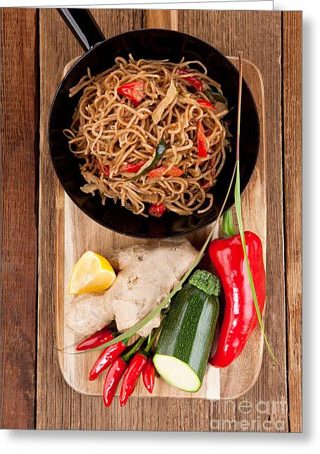 Noodles Greeting Cards - Noodles with fresh vegetables on a wooden table Greeting Card by Wolfgang Steiner