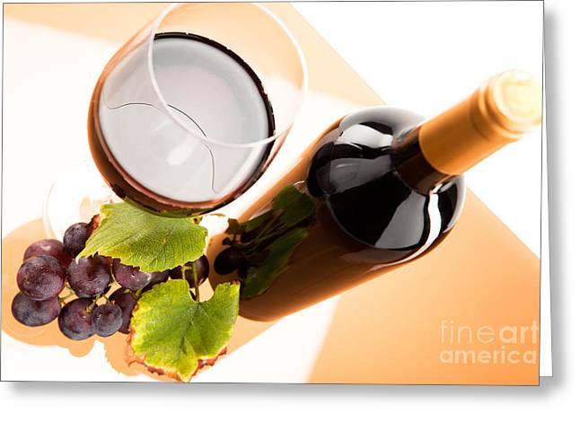 Red Wine Greeting Cards - Red wine in glass with bottle and wine grapes Greeting Card by Wolfgang Steiner