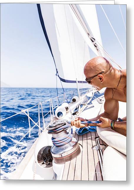 Sailing Ship Greeting Cards - Handsome man on sailboat Greeting Card by Anna Omelchenko