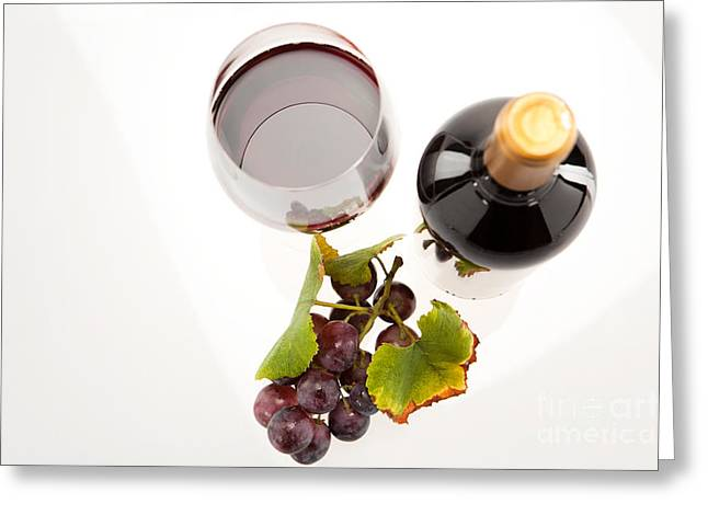 Party Greeting Cards - Red wine in glass with bottle and wine grapes Greeting Card by Wolfgang Steiner