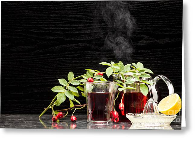 Beverage Greeting Cards - Rosehip tea with lemon in glass Greeting Card by Wolfgang Steiner