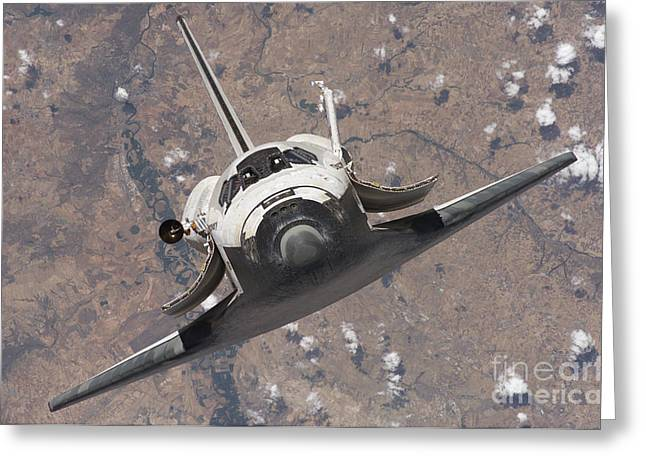 Docking Greeting Cards - Space Shuttle Discovery Greeting Card by Stocktrek Images