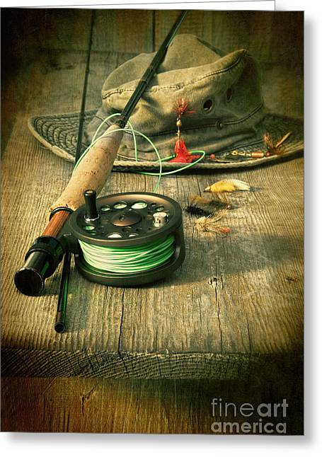 Fishing Rods Greeting Cards - Fly fishing equipment with old hat on bench Greeting Card by Sandra Cunningham