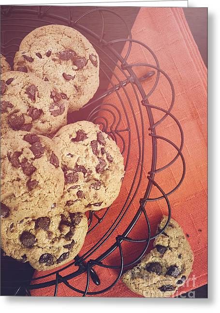 Sun Baking Greeting Cards - Chocolate Chip Cookies on Dark Wood Background.  Greeting Card by Milleflore Images