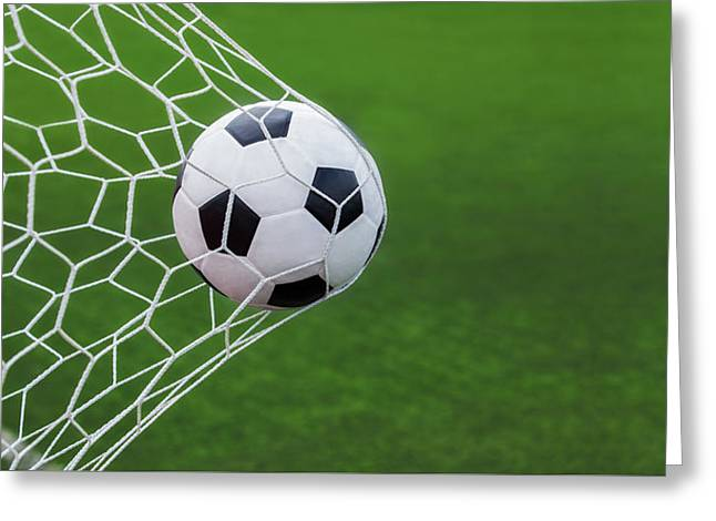 Sporting Activities Greeting Cards - Soccer Ball In Goal  Greeting Card by Anek Suwannaphoom