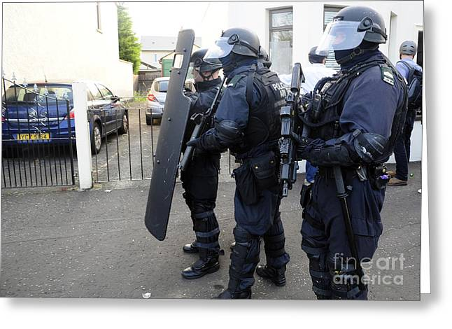 Police Officer Photographs Greeting Cards - Loyalist Protesters Attack Police Lines Greeting Card by Andrew Chittock