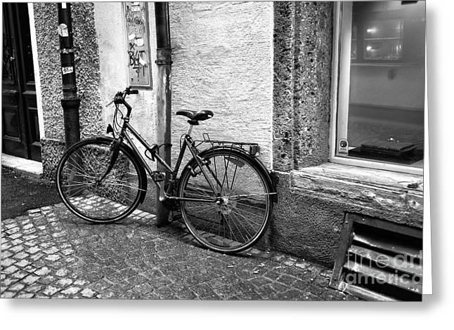Salzburg Greeting Cards - A Bike in Salzburg Greeting Card by John Rizzuto