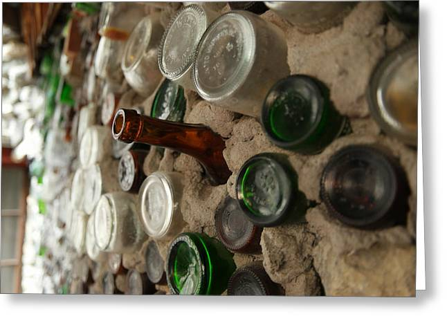 Glass Wall Photographs Greeting Cards - A bottle in the wall Greeting Card by Jeff  Swan