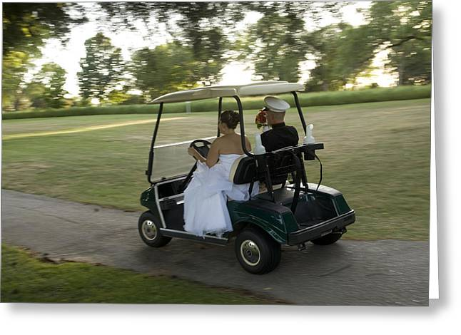Just Married Greeting Cards - A Bride And Groom Ride On A Golf Cart Greeting Card by Joel Sartore