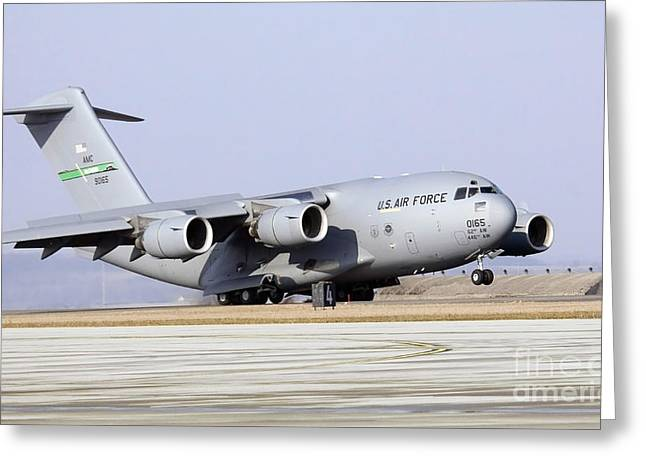 Freight Aircraft Greeting Cards - A C-17 Globemaster Iii Lands Greeting Card by Stocktrek Images