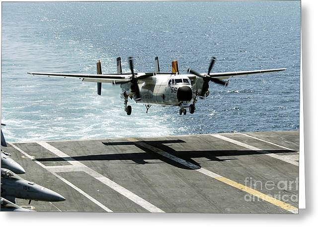 Aircraft Carrier Greeting Cards - A C-2a Greyhound Prepares To Land Greeting Card by Stocktrek Images