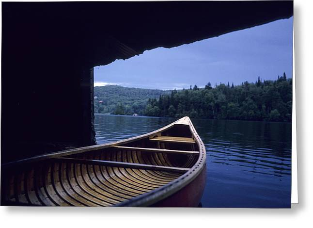 Swim Ladder Greeting Cards - A Canoe Sticks Out Of A Boathouse On An Greeting Card by Taylor S. Kennedy