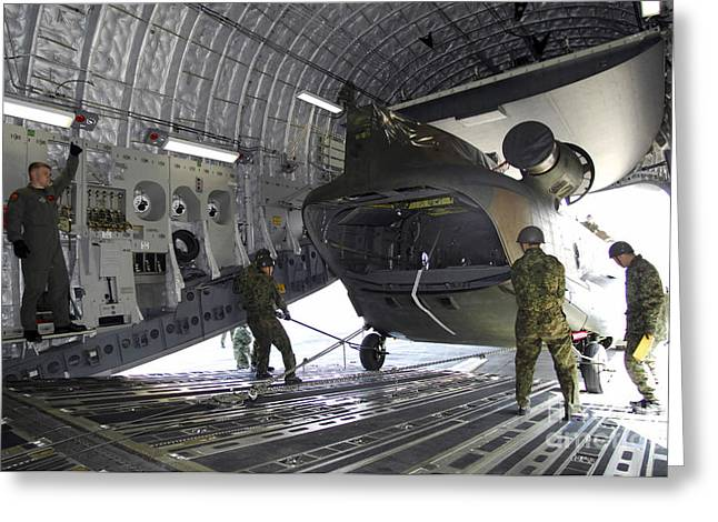 Freight Aircraft Greeting Cards - A Ch-47j Chinook Is Loaded Onto A C-17 Greeting Card by Stocktrek Images
