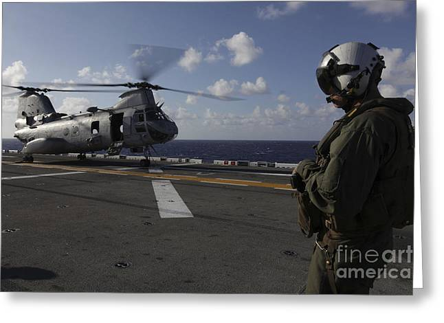 Ch-46 Greeting Cards - A Crew Chief Watches A Ch-46e Sea Greeting Card by Stocktrek Images