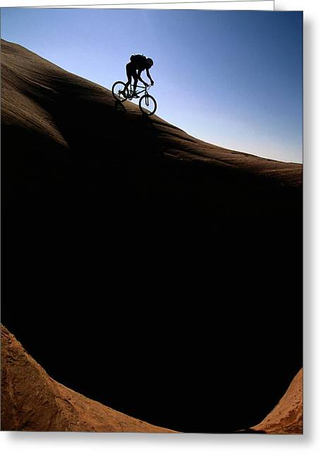 Release Greeting Cards - A Cyclist Riding On The Slick Rock Greeting Card by Bill Hatcher
