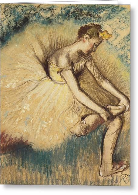 Dancing Girl Pastels Greeting Cards - A Dancer Putting on her Shoe Greeting Card by Edgar Degas