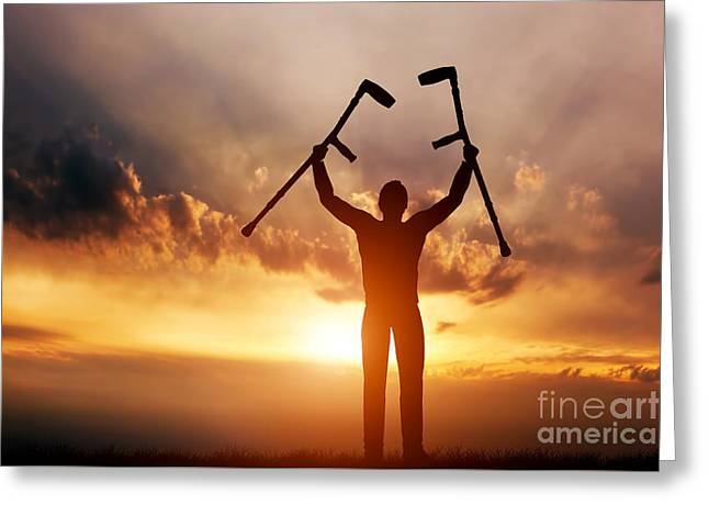 A Disabled Man Raising His Crutches At Sunset Greeting Card by Michal Bednarek