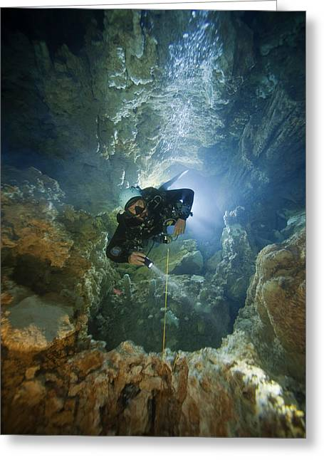 Directly Below Greeting Cards - A Diver Ascends A Deep Shaft In Dans Greeting Card by Wes C. Skiles