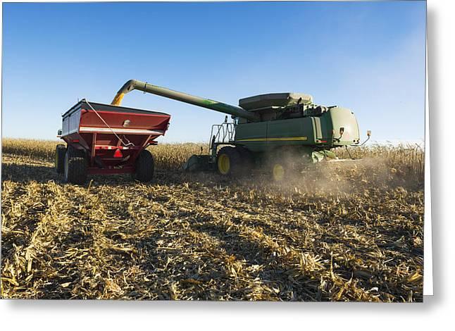 Corn Wagon Greeting Cards - A Farmer Augers Yellow Grain Corn Greeting Card by Scott Sinklier