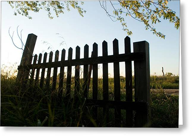 Property-released Photography Greeting Cards - A Fence Is Silhouetted Against The Sky Greeting Card by Joel Sartore