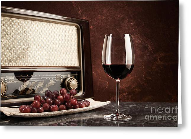 Red Wine Greeting Cards - A glass of red wine with music from the radio Greeting Card by Wolfgang Steiner