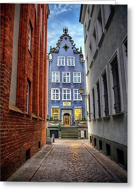 A Glimpse Of Mariacka Street In Gdansk Poland Greeting Card by Carol Japp