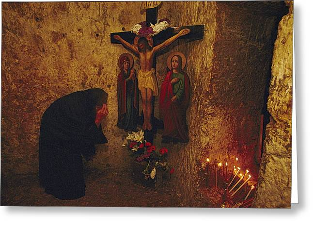 Bowing Greeting Cards - A Greek Pilgrim Prays In The Grotto Greeting Card by Annie Griffiths