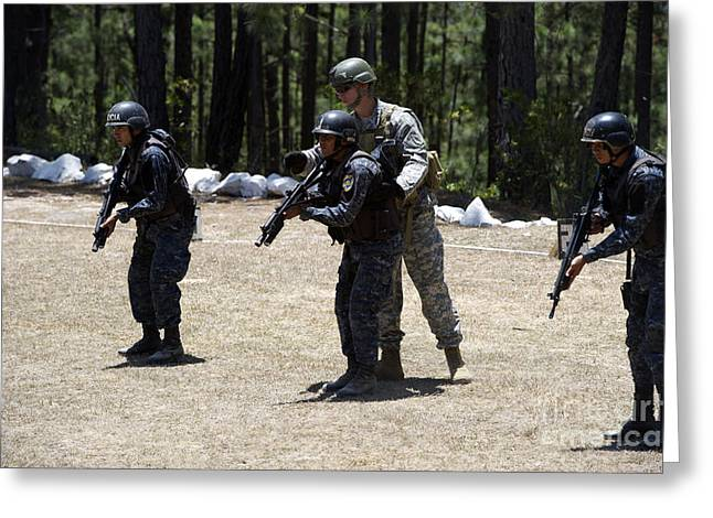 Military Police Greeting Cards - A Green Beret Instructs Tigres Trainees Greeting Card by Stocktrek Images