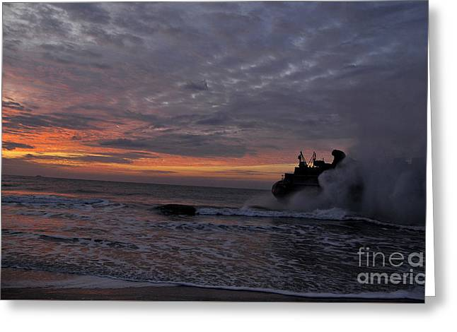 Landing Craft Greeting Cards - A landing craft air cushion  at sunset Greeting Card by Celestial Images