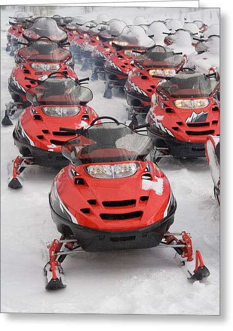 Snowmobile Greeting Cards - A Large Group Of Snowmobiles Sit Greeting Card by Taylor S. Kennedy