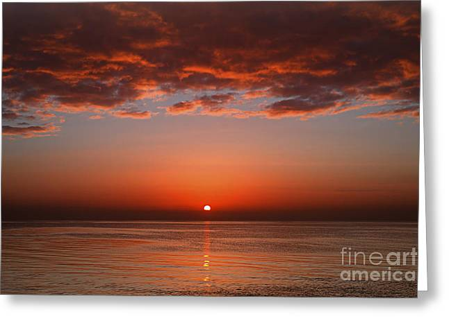 Reflections In River Greeting Cards - A Layer Of Clouds Is Lit By The Rising Greeting Card by Luis Argerich