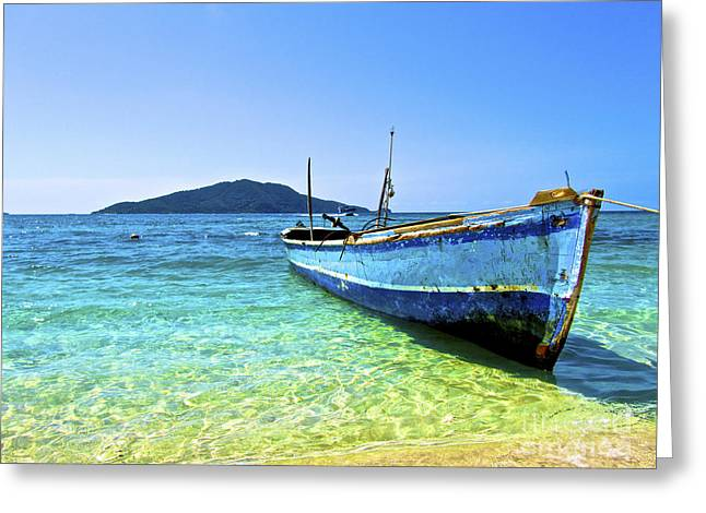 Ethereal Beach Scene Greeting Cards - A Lone Boat On The Shore Of Cayos Greeting Card by Amanda Nicholls
