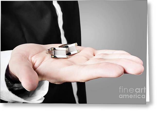 Cufflinks Greeting Cards - A male model showcasing cuff links in his hand Greeting Card by Ryan Jorgensen