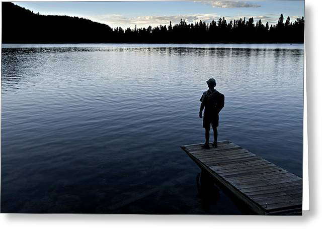 A Man Looking Across A Lake. Into Greeting Card by Dawn Kish