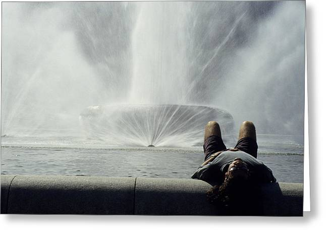 A Man Relaxes At A Fountain Greeting Card by Stacy Gold