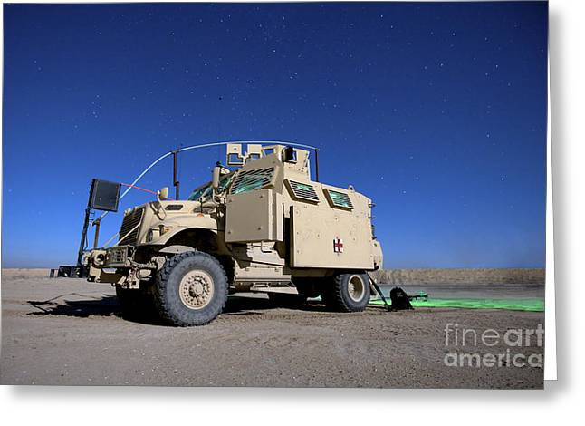 Looking At The Stars Greeting Cards - A Maxxpro Mrap Vehicle Under A Starry Greeting Card by Terry Moore