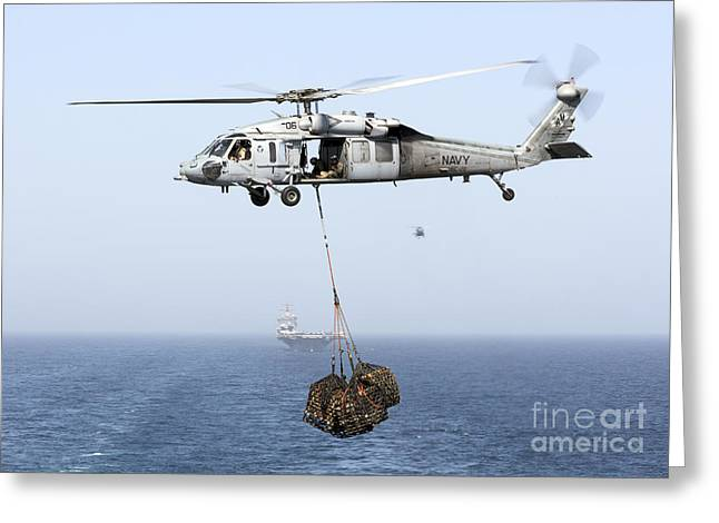 Arabian Sea Greeting Cards - A Mh-60 Helicopter Transfers Cargo Greeting Card by Gert Kromhout