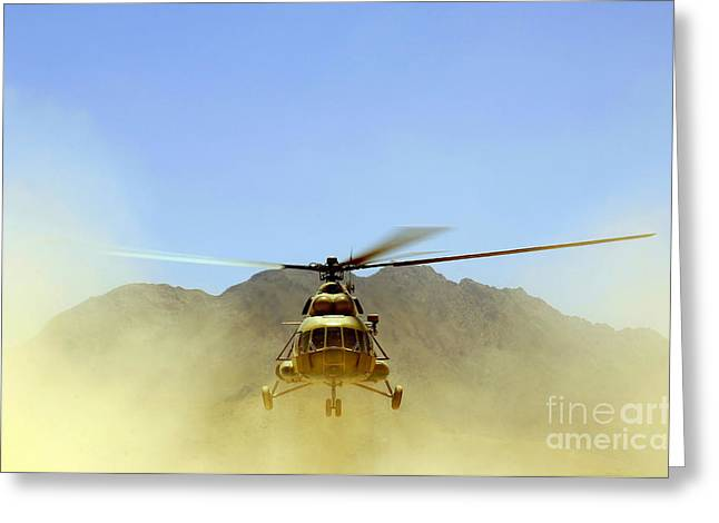 Rotorcraft Photographs Greeting Cards - A Mi-17 Hip Helicopter Hovers Greeting Card by Stocktrek Images