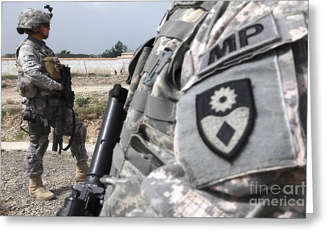 A Military Police Officer Provides Greeting Card by Stocktrek Images