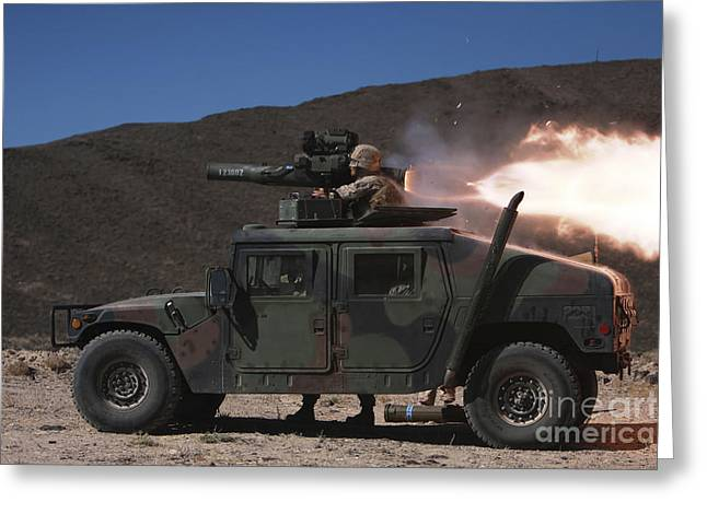 Hmmwv Greeting Cards - A Missileman Firing A Bgm-71 Tow Greeting Card by Stocktrek Images