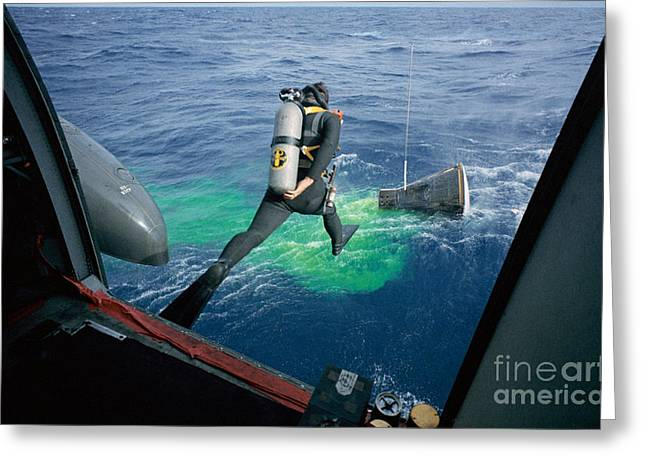 Edwin A Greeting Cards - A Navy frogman leaps from recovery helicopter into water to assist the Gemini 12 recovery operations Greeting Card by R Muirhead Art