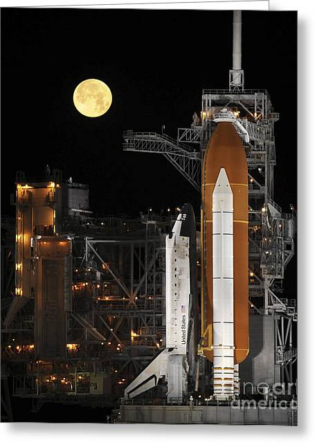 Rocket Boosters Greeting Cards - A Nearly Full Moon Sets As Space Greeting Card by Stocktrek Images
