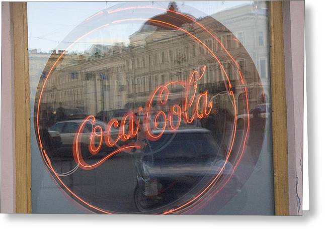 Etc Greeting Cards - A Neon Coca Cola Sign Is Displayed Greeting Card by Richard Nowitz