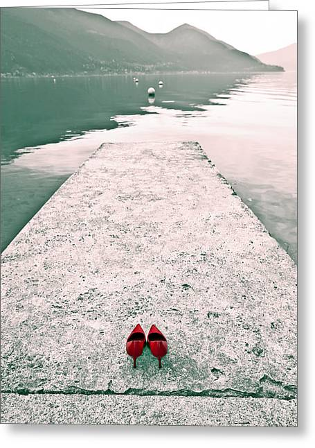 Red Shoes Greeting Cards - A Pair Of Red Womens Shoes Lying On A Walkway That Leads Into A Greeting Card by Joana Kruse