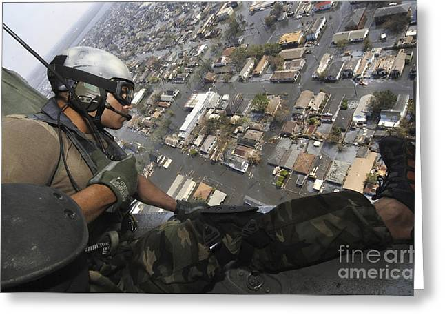New Orleans Home Greeting Cards - A Pararescueman Surveys Houses Looking Greeting Card by Stocktrek Images