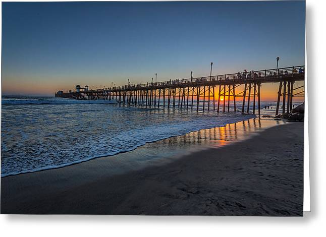 A Piers To Be Last Light Greeting Card by Peter Tellone