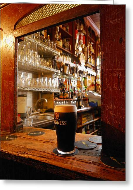 Local Food Greeting Cards - A Pint Of Dark Beer Sits In A Pub Greeting Card by Jim Richardson
