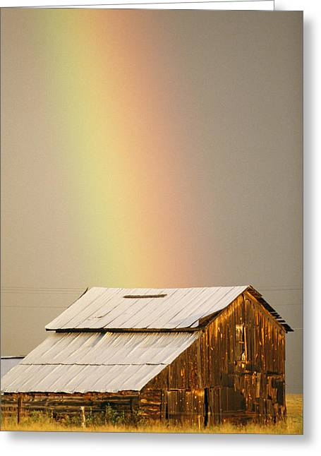 Farmers And Farming Greeting Cards - A Rainbow Arches From The Sky Onto Greeting Card by Michael S. Lewis