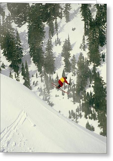 Tricks Greeting Cards - A Skier Jumps Off Of A Cliff Greeting Card by Gordon Wiltsie