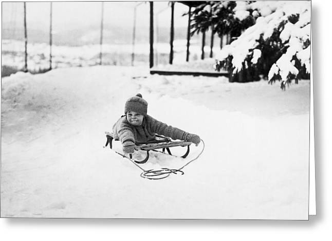A Small Girl On A Sled Greeting Card by Underwood Archives
